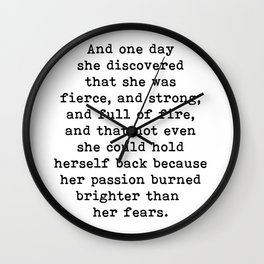 And one day she discovered that she was fierce and strong Wall Clock