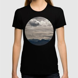 Clouds rolling over T-shirt