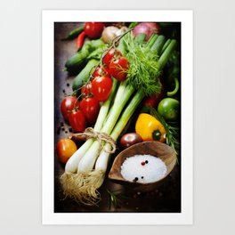 fresh spring onions and vegetables on a wooden board Art Print