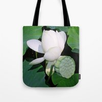 lotus Tote Bags featuring Lotus. by Assiyam