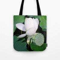 lotus flower Tote Bags featuring Lotus. by Assiyam