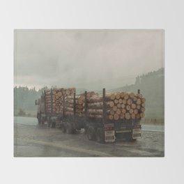 Loggers in the Rain Throw Blanket