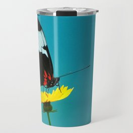 butterfly on yellow flower blue background Travel Mug