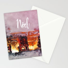 A tiny Christmas village on my mantle says Noel Stationery Cards