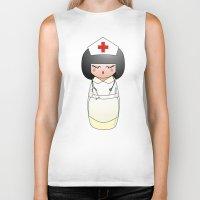 nurse Biker Tanks featuring Kokeshi Nurse by Pendientera
