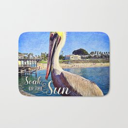 """Soak up the Sun"" quote cute California beach pier pelican Bath Mat"