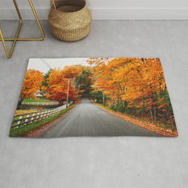 autumnal road in new england Rug