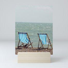 Vintage beach deckchairs Mini Art Print