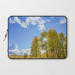 Autumn landscape: colorful trees, blue sky and the sun. Laptop Sleeve