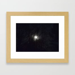 hazy moon through trees Framed Art Print
