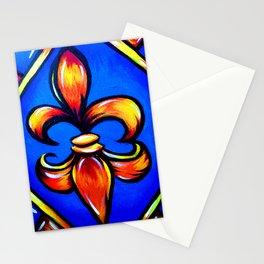 Orange Fleur d Lis against blue background Stationery Cards