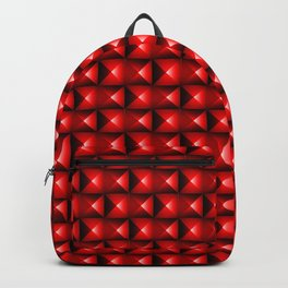 Pattern of red squares with white highlights and black triangles. Backpack