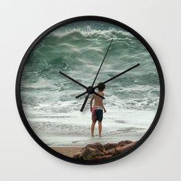 small boy against the sea Wall Clock