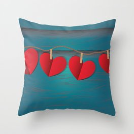 Red paper hearts tie to a rope Throw Pillow