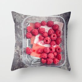 Raspberries in plastic container Throw Pillow