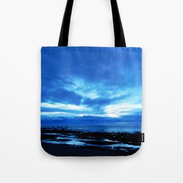 Arm from Above Plays with the Sunset Tote Bag