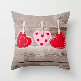 II - Clothesline with Valentine's Day hearts decorations on a rustic background Throw Pillow
