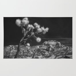 Joshua Trees and Boulders in Infrared Black and White at Joshua Tree National Park California Rug