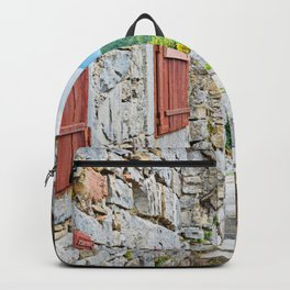 Town of Hum stone gate and street view Backpack