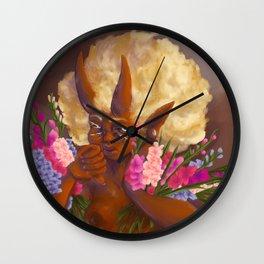 Demon holding gladioli. Wall Clock