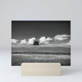 Unique a single oak tree among the clouds Mini Art Print