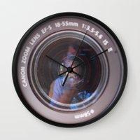 inception Wall Clocks featuring Camera Inception by Devon Pankiw