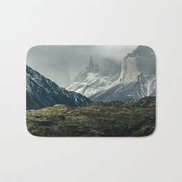 Menacing Mountain peaks with fog coming in Bath Mat