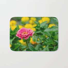 Pink flower, in green and yelow Bath Mat