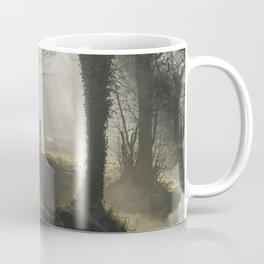 Sunlight through mist and fog over an old wooden footbridge. Norfolk, UK. Coffee Mug