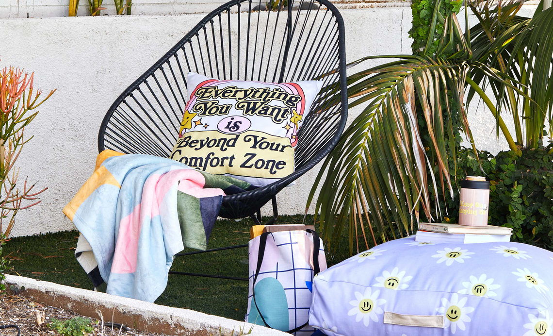 outdoor chair with pillows, blankets, outdoor floor cushion and can cooler