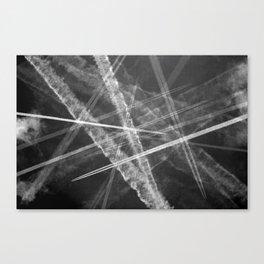 Jet vapour trails in a dark sky Canvas Print