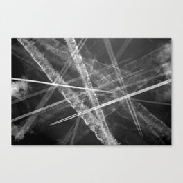 Jet vapour trails in a dark sky Canvas Print