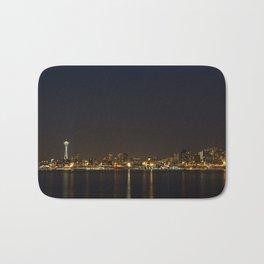 The Seattle, Washington skyline at night Bath Mat