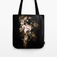 astronaut Tote Bags featuring Astronaut by Andreas Lie