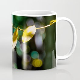 Yellow leaves in colorful bokeh Coffee Mug