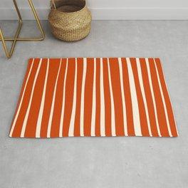 Vertical irregular stripes on orange Rug