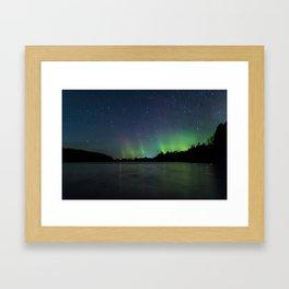 Northern Lights above a lake Framed Art Print