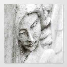 Angel face on stone memorial eyes closed Canvas Print