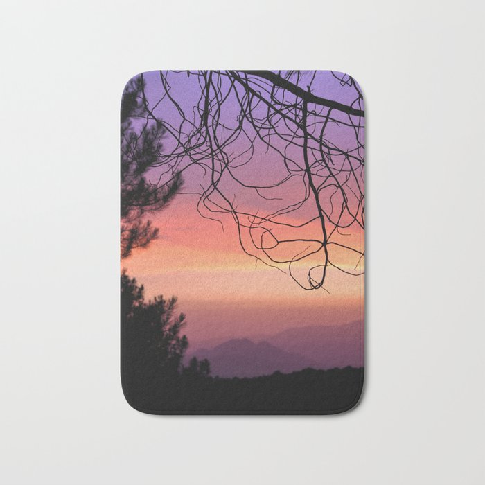 Purple sunset. At the woods Bath Mat