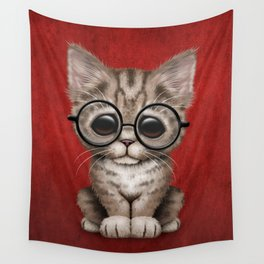 Cute Brown Tabby Kitten Wearing Eye Glasses on Red Wall Tapestry