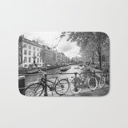 Bicycles parked on bridge over Amsterdam canal Bath Mat
