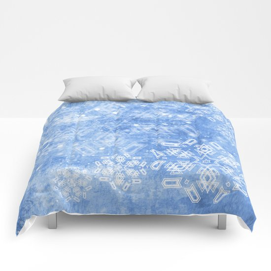 Abstract snow flakes on blue texture Comforters