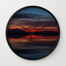 Final light of sunset turning sky and water red Wall Clock