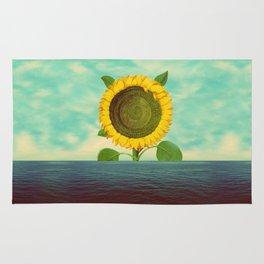 Sun in the ocean Rug