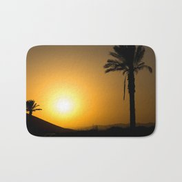 Golden Andalusian sunset with silhouette palm trees and mountain Bath Mat