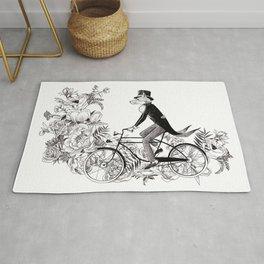 Foxy ride - British fox on a bike illustration Rug