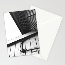 wood building in the city in black and white Stationery Cards