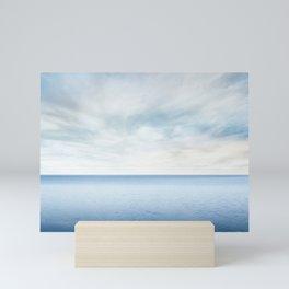 Beautiful sea level with fantasy blue sky Mini Art Print