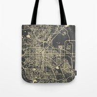 denver Tote Bags featuring Denver map by Map Map Maps