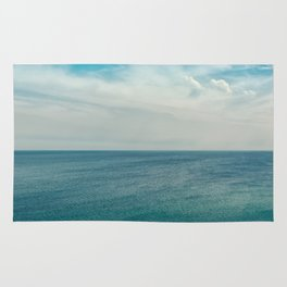 Cliff into the ocean Rug